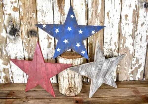 3 rustic wooden patriotic starts in red white and blue