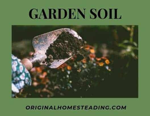shovel full of soil with text overlay Garden Soil by OriginalHomesteading.com