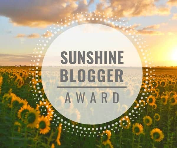 field of sunflowers with text overlay Sunshine Blogger Award