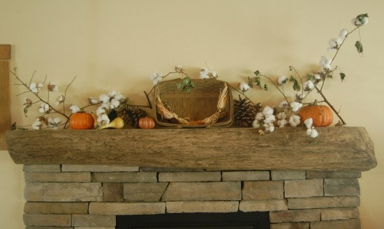 fall decorated mantel with pumpkins gourds dried corn and boughs of cotton with a basket