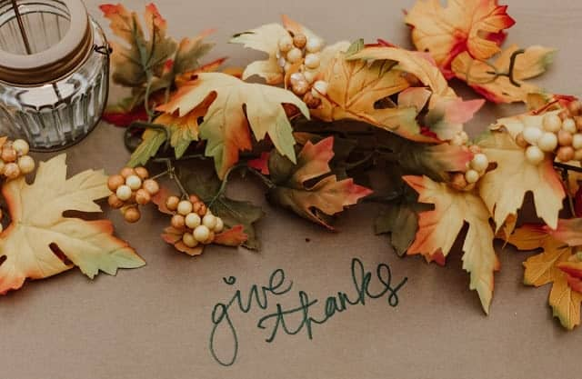fall leaves with text overlay give thanks
