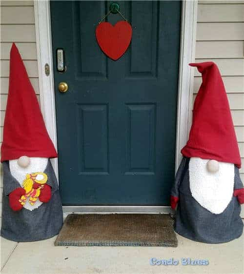 two handmade outdoor Christmas Gnomes by the front door