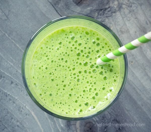 closeup of a green smoothie with a straw