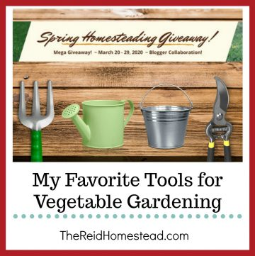 garden tools on wood with text overlay Spring Homesteading Giveaway and My Favorite Tools for Vegetable Gardening