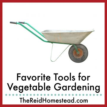 photo of a wheelbarrow with text overlay Favorite Tools for Vegetable Gardening