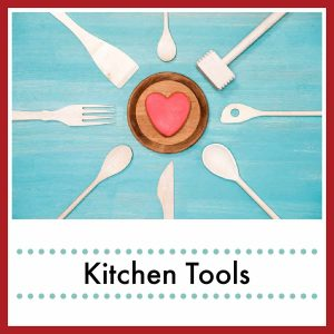 kitchen utensils in a circle around a wood heart with text overlay Kitchen Tools